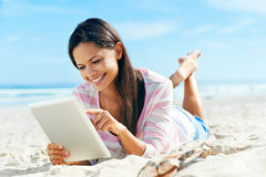 Tablet beach woman Royalty Free Stock Photo