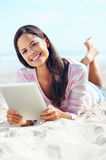 Tablet beach woman Royalty Free Stock Image