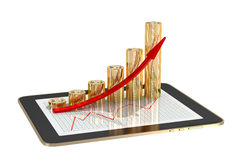 Tablet - bitcoins. Tablet - bar graphs made from bitcoins showing profit grow Stock Images
