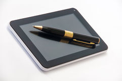 Tablet with a black ballpoint pen on the screen Royalty Free Stock Photography