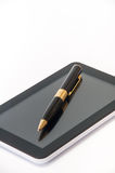 Tablet with a black ballpoint pen on the screen Royalty Free Stock Images