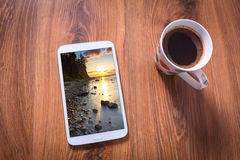 Tablet and black coffee Stock Photos