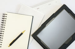 Tablet with blank notebooks and a pen Royalty Free Stock Photo