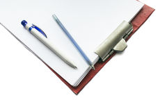 Tablet with blank paper and two pens Royalty Free Stock Image