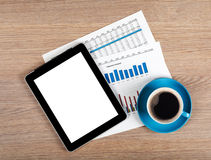 Tablet with blank screen and coffee cup stock images