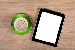 Tablet with blank screen and coffee cup Royalty Free Stock Photo