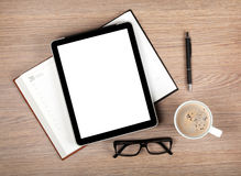 Tablet with blank screen and coffee cup Royalty Free Stock Photos