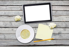 Tablet with blank screen and cup of coffee Stock Photos