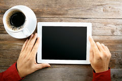 Tablet. With a blank screen in the hands, Useful for background Stock Photography