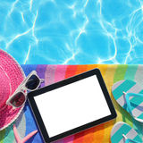 Tablet with blank screen by poolside Stock Image