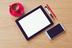 Tablet with blank screen on wooden table. Office desk mock up. View from above Stock Images