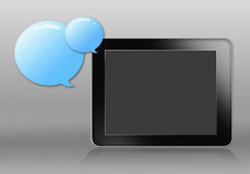Tablet and blue bubble Stock Image