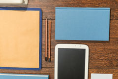 Tablet and book Royalty Free Stock Photos