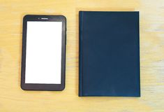 Tablet and book Stock Photography