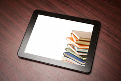 Tablet with book Stock Photos