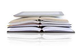 Tablet and books. Compare a tablet and books Stock Image