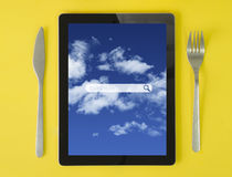 Tablet breakfast search Royalty Free Stock Photo