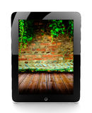 Tablet with brick wall Stock Photography