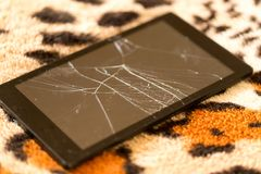 Tablet with a broken screen on the background of tiger skin.  stock images