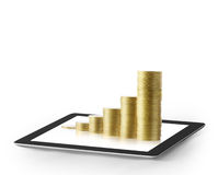 Tablet  with business graph and golden coin Stock Photography