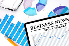 Tablet with  business news of stock market Royalty Free Stock Photo