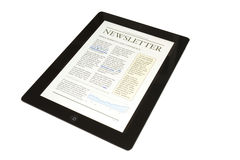 Tablet with business newsletter Royalty Free Stock Photo