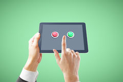 Tablet with buttons green background Stock Image
