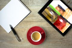 Tablet with can of glass and note pad for purchase list. As top view Stock Photography