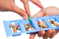 Tablet and capsule in daily pill box Royalty Free Stock Photos
