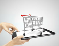 Tablet with cart Stock Photo