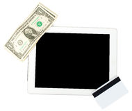 Tablet with cash and credits Royalty Free Stock Photography