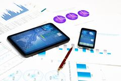 Tablet, cell phone and financial documents Stock Photography