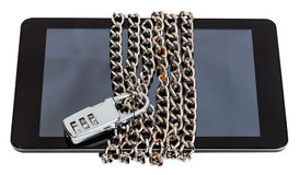 Tablet chained and closed by combination lock Royalty Free Stock Images