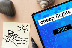 Tablet with cheap flights. Stock Image