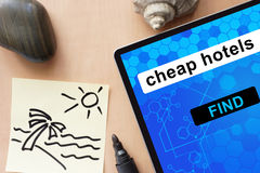 Tablet with cheap hotels. Stock Photo