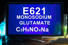 Tablet with chemical formula of  e621 monosodium glutamate  . Royalty Free Stock Image