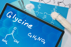 Tablet with the chemical formula of  Glycine. Stock Photos