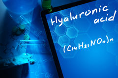 Tablet with the chemical formula of hyaluronic acid. Test tubes, tablets and chemical formulas Stock Image