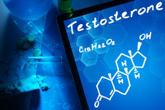 Tablet with the chemical formula of testosterone. Royalty Free Stock Images