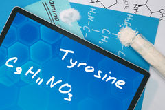 Tablet with the chemical formula of  Tyrosine . Amino acids Royalty Free Stock Photo