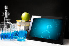 Tablet with chemistry symbols Stock Photo
