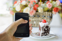 Tablet with chocolate cake on a table Royalty Free Stock Images
