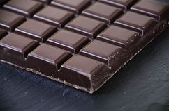 Tablet of chocolate. Candy tablet of black chocolate Royalty Free Stock Images