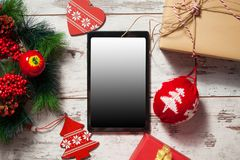 Tablet on Christmas background royalty free stock photography