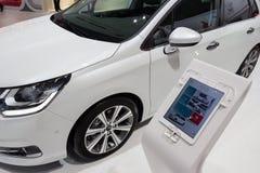 Tablet with Citroen C4 car. GENEVA, SWITZERLAND - MARCH 4, 2015: Tablet with Citroen C4 car specifications on the 85th International Geneva Motor Show in Palexpo Royalty Free Stock Photo
