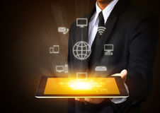 Tablet with cloud of  application icons Stock Photos