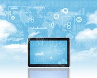 Tablet in cloud sky Stock Photo