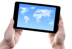 Tablet cloud world map. Hands holding a computer tablet device with cloud world map on the screen Royalty Free Stock Photos