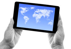 Tablet cloud world map Royalty Free Stock Image