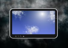 Tablet and clouds Royalty Free Stock Photography